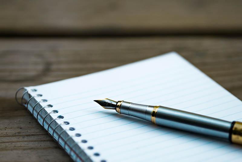 Тетрадь и ручка